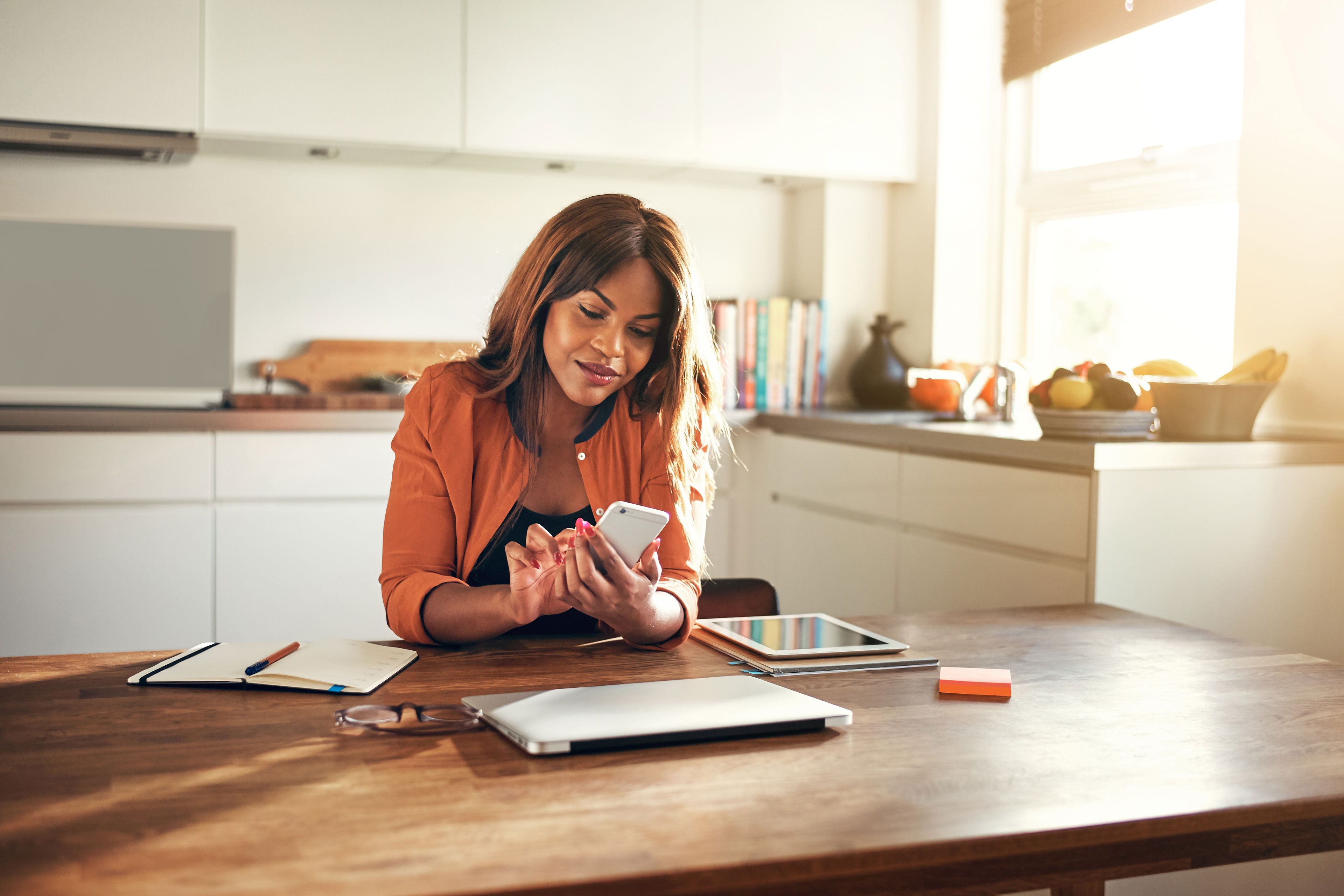 Woman looking at her phone at home