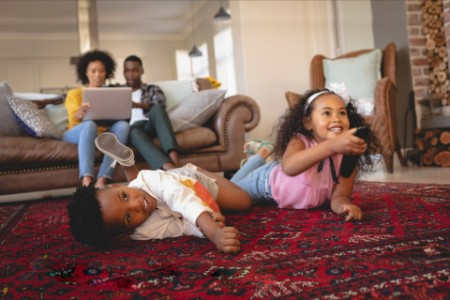 EY African American family streaming and watching tv together