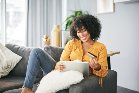 EY - African American woman online shopping from home