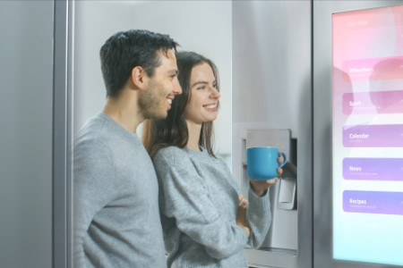 EY - Couple looking at smart refrigerator