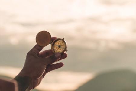 EY - Hand holding navigational compass