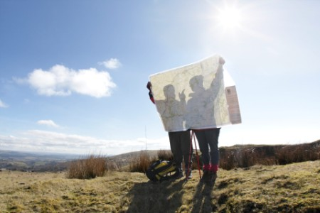 EY - Two hikers looking at map
