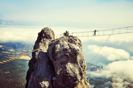 Man is walking along a bridge