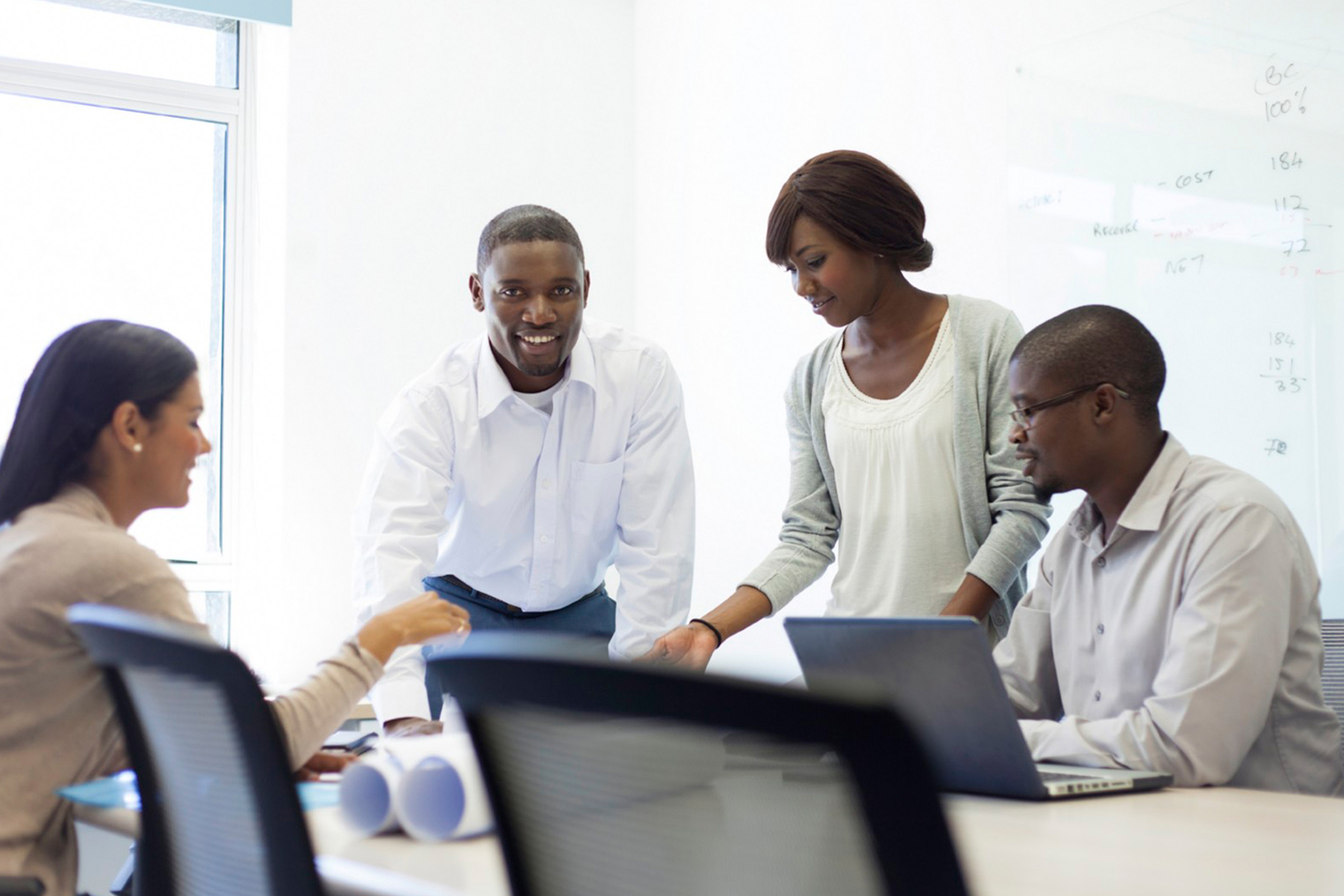 Group of people discussing in office