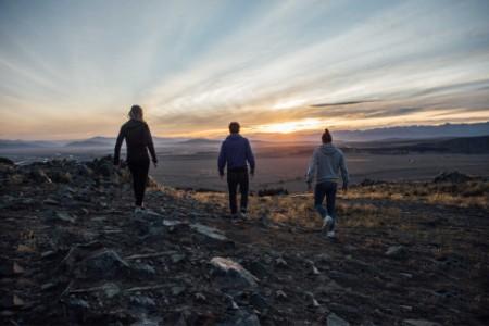 ey-rear-view-of-friends-walking-on-landscape