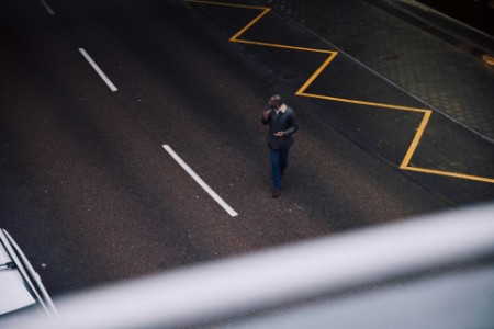 ey-man-watches-for-traffic-as-he-crosses-the-street