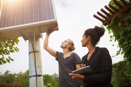 garden architect adjusting solar panel