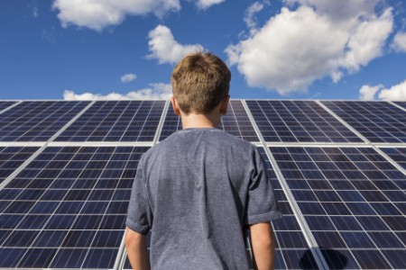 Boy with solar panels