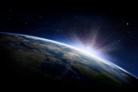 Sun rising behind the earth