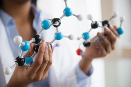 Woman with molecular model