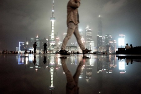 Man walking with a city in the backgound