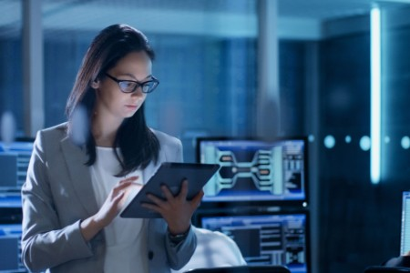 Woman with a tablet in a server room