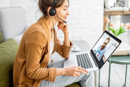 Business woman having a video call with coworker