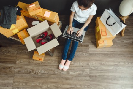 Asian teenager owner business woman work at home for online shopping and sale.