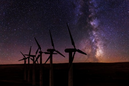 Wind turbines on a background of the starry sky