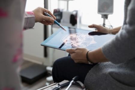 Close up doctor explaining digital brain scan