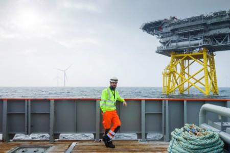 Photo of man standing on oil platform