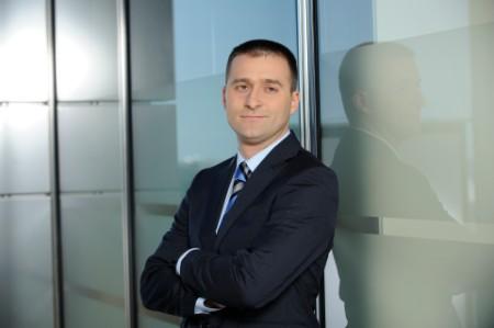 EY - Grzegorz Kaczor