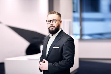 EY - Piotr Chęciek