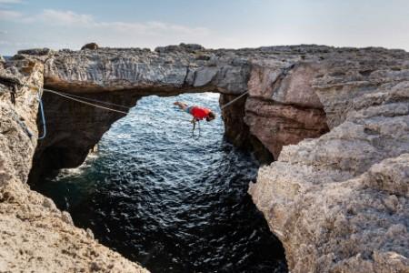 EY brave man doing rope rafting adventure