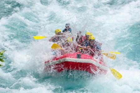 EY people enjoying while water rafting