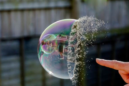 EY man playing with water bubble