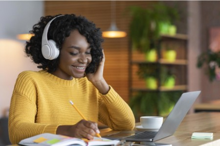 EY business woman enjoying while working at home