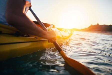 man holding kayak paddle