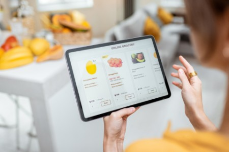 EY person selecting groceries ecommerce website