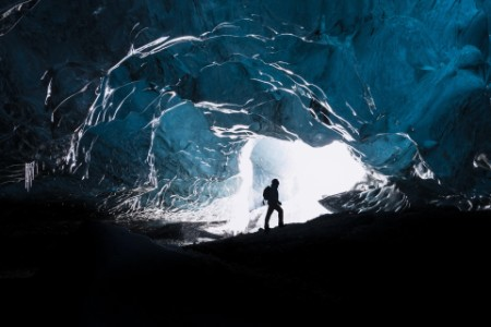The explorer inside the mountain cave
