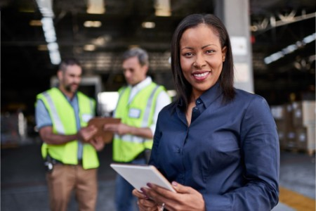EY woman managing goods at industry