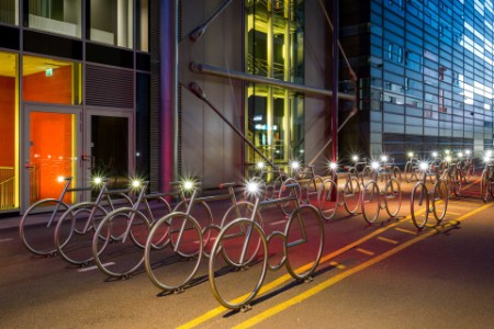 EY bicycles stand at building parking zone