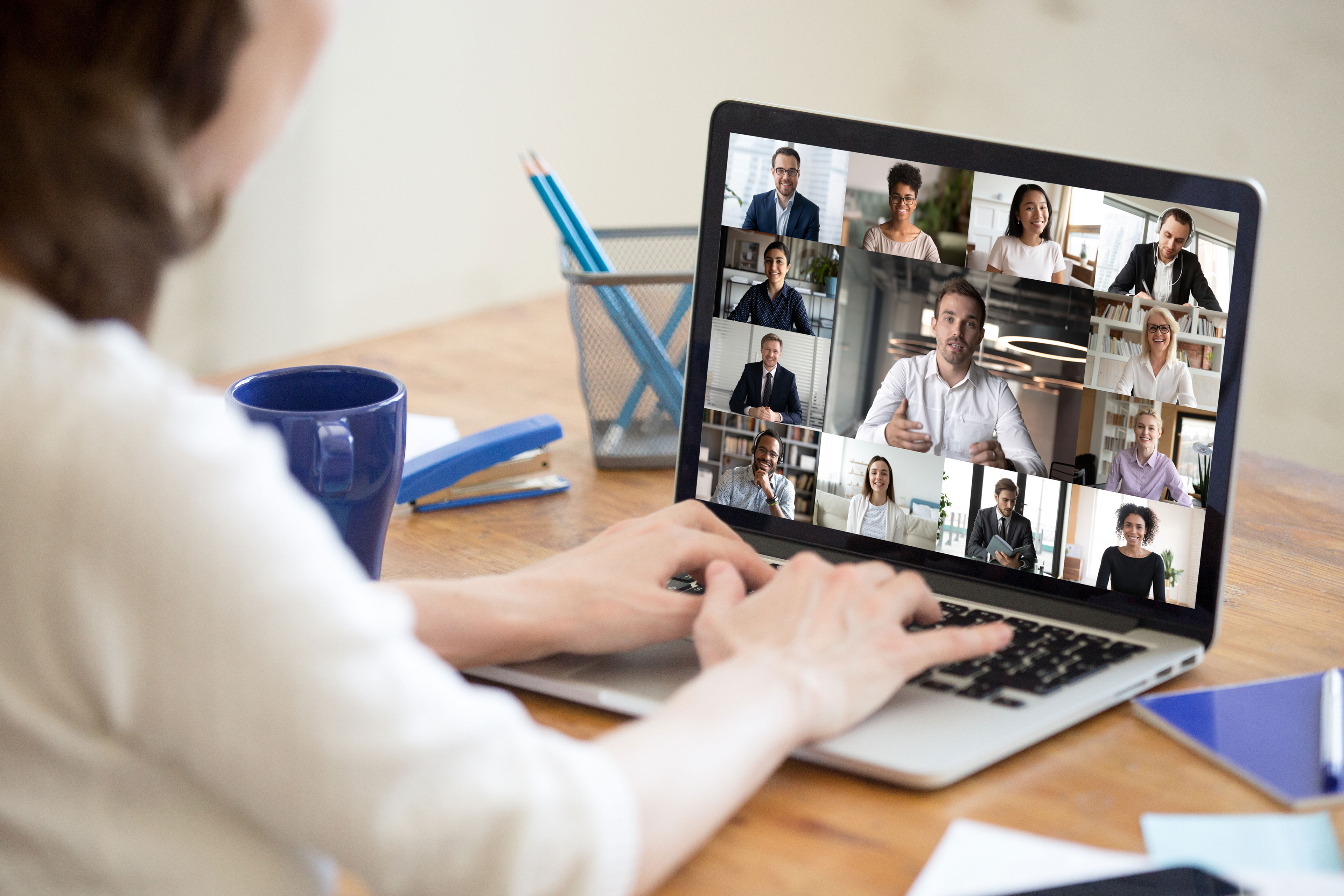 Staff sharing ideas in video conference call