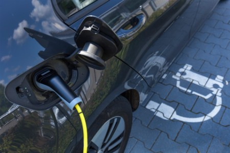EY electric car getting charge