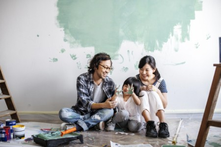 Family renovating the house with smile