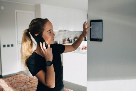 EY girl checking the to-do list in smart gadget