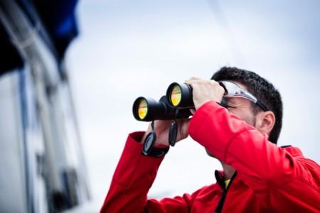 EY man seeing the views through binoculars