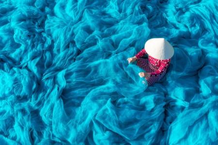 Woman weaving nets