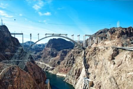 Power transmission lines bridge between mountains