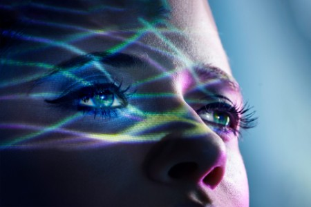 EY Woman disco lights on her eyes