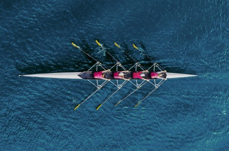team of women rowing boat
