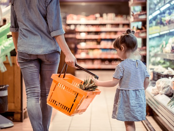 Mom and daughter are shopping at the supermarket