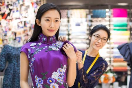 Asian Fashion Designer Adjusting Customers Dress